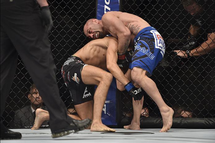 LAS VEGAS, NV - SEPTEMBER 27:  Manval Gamburyan chokes Cody Gibson in their bantamweight fight during the UFC 178 event inside the MGM Grand Garden Arena on September 27, 2014 in Las Vegas, Nevada.  (Photo by Jeff Bottari/Zuffa LLC/Zuffa LLC via Getty Ima