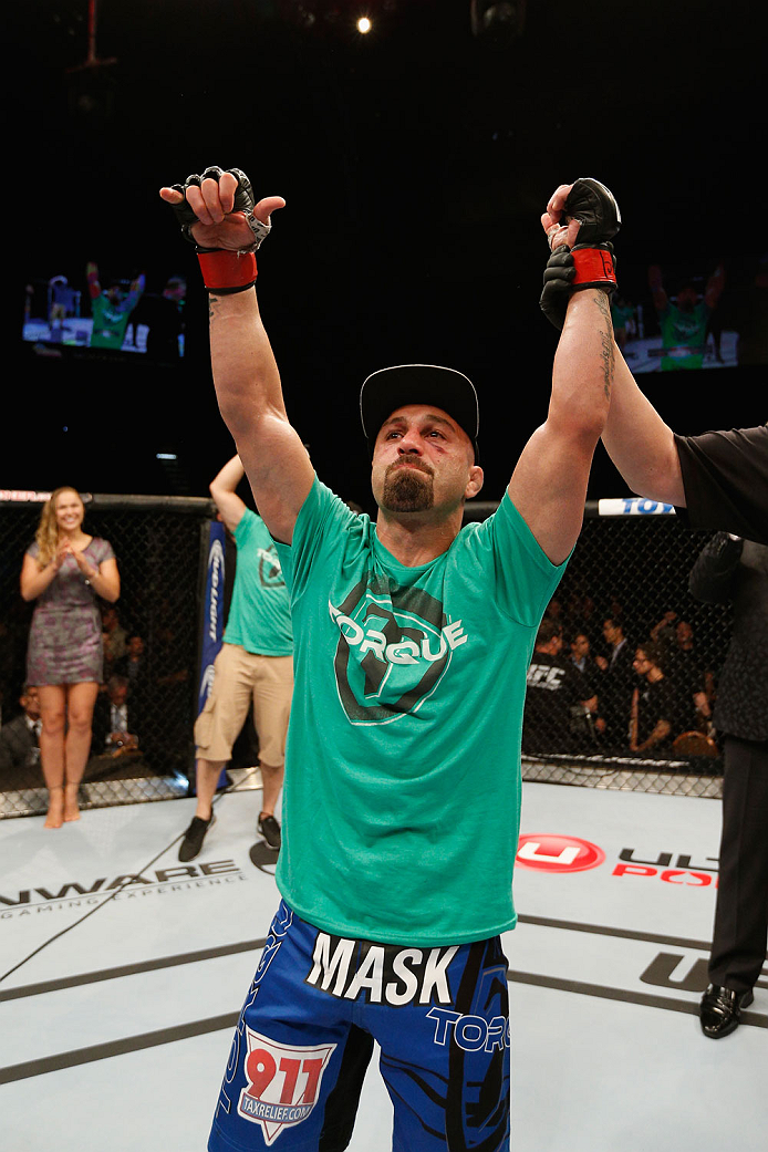 LAS VEGAS, NV - SEPTEMBER 27:  Manval Gamburyan celebrates his submission victory over Cody Gibson in their bantamweight fight during the UFC 178 event inside the MGM Grand Garden Arena on September 27, 2014 in Las Vegas, Nevada.  (Photo by Josh Hedges/Zu