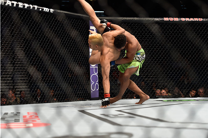 LAS VEGAS, NV - SEPTEMBER 27: (R-L) Kevin Lee takes down Jon Tuck in their lightweight fight during the UFC 178 event inside the MGM Grand Garden Arena on September 27, 2014 in Las Vegas, Nevada.  (Photo by Jeff Bottari/Zuffa LLC/Zuffa LLC via Getty Image