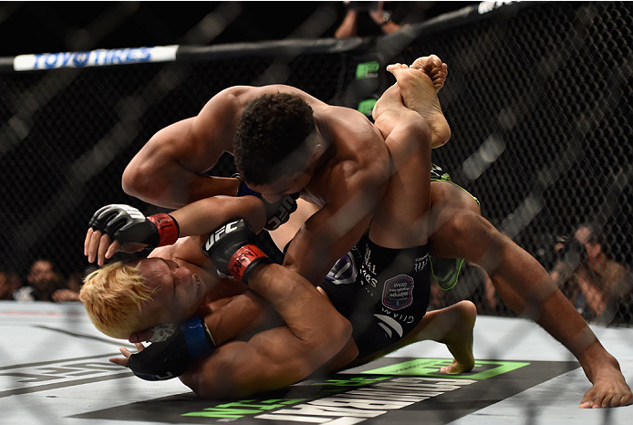 LAS VEGAS, NV - SEPTEMBER 27:  Kevin Lee controls the body of Jon Tuck in their lightweight fight during the UFC 178 event inside the MGM Grand Garden Arena on September 27, 2014 in Las Vegas, Nevada.  (Photo by Jeff Bottari/Zuffa LLC/Zuffa LLC via Getty