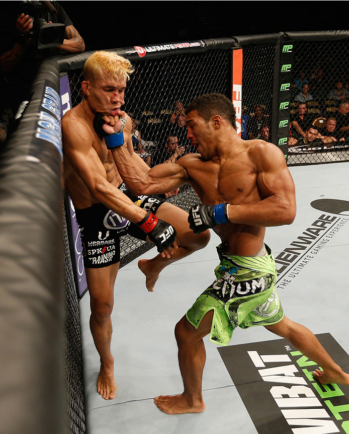 LAS VEGAS, NV - SEPTEMBER 27:  (L-R) Kevin Lee punches Jon Tuck in their lightweight fight during the UFC 178 event inside the MGM Grand Garden Arena on September 27, 2014 in Las Vegas, Nevada.  (Photo by Josh Hedges/Zuffa LLC/Zuffa LLC via Getty Images)