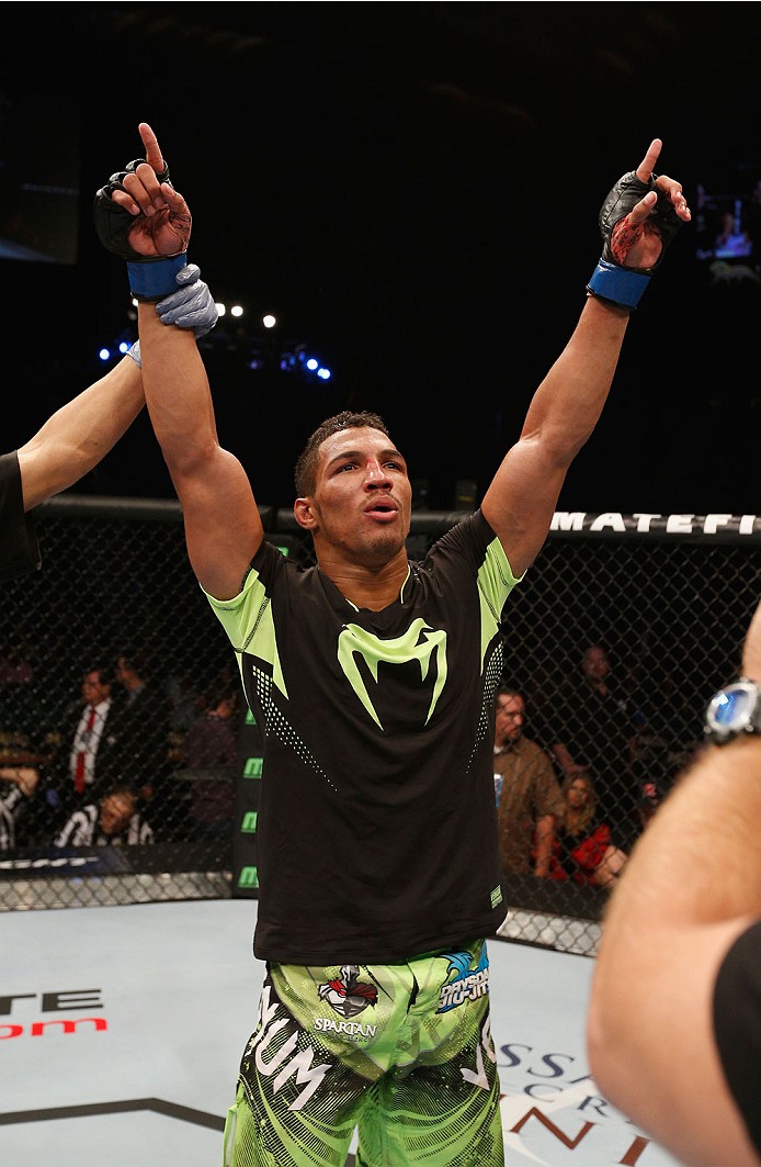 LAS VEGAS, NV - SEPTEMBER 27:  Kevin Lee celebrates after defeating Jon Tuck in their lightweight fight during the UFC 178 event inside the MGM Grand Garden Arena on September 27, 2014 in Las Vegas, Nevada.  (Photo by Josh Hedges/Zuffa LLC/Zuffa LLC via G