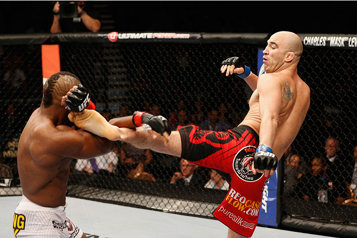 LAS VEGAS, NV - SEPTEMBER 27:  (R-L) Brian Ebersole kicks John Howard in their welterweight fight during the UFC 178 event inside the MGM Grand Garden Arena on September 27, 2014 in Las Vegas, Nevada.  (Photo by Josh Hedges/Zuffa LLC/Zuffa LLC via Getty I