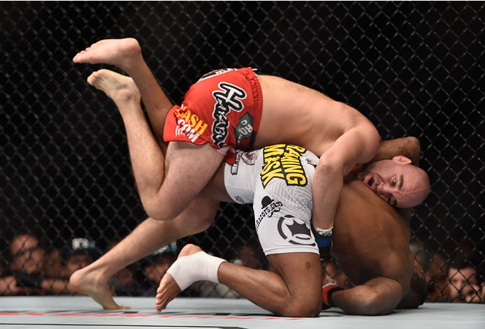 LAS VEGAS, NV - SEPTEMBER 27:  (Top) Brian Ebersole grapples with John Howard in their welterweight fight during the UFC 178 event inside the MGM Grand Garden Arena on September 27, 2014 in Las Vegas, Nevada.  (Photo by Jeff Bottari/Zuffa LLC/Zuffa LLC vi