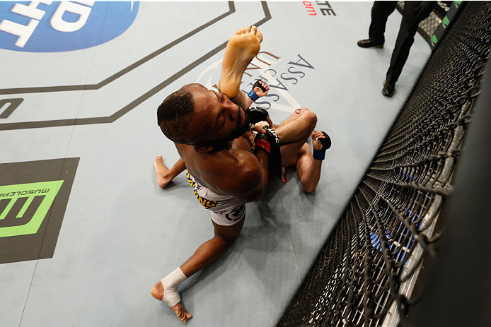 LAS VEGAS, NV - SEPTEMBER 27:  (Bottom) Brian Ebersole performs an illegal upkick on John Howard in their welterweight fight during the UFC 178 event inside the MGM Grand Garden Arena on September 27, 2014 in Las Vegas, Nevada.  (Photo by Josh Hedges/Zuff