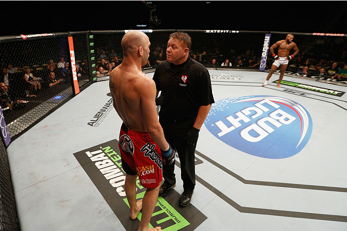 LAS VEGAS, NV - SEPTEMBER 27:  (L-R) Brian Ebersole is given a warning for an illegal upkick against John Howard in their welterweight fight during the UFC 178 event inside the MGM Grand Garden Arena on September 27, 2014 in Las Vegas, Nevada.  (Photo by