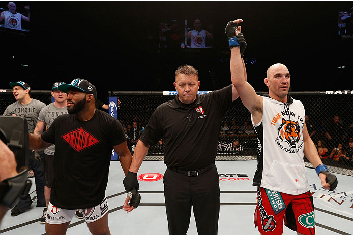 LAS VEGAS, NV - SEPTEMBER 27:  (R-L) Brian Ebersole celebrates his split decision win over John Howard after their welterweight fight during the UFC 178 event inside the MGM Grand Garden Arena on September 27, 2014 in Las Vegas, Nevada.  (Photo by Josh He