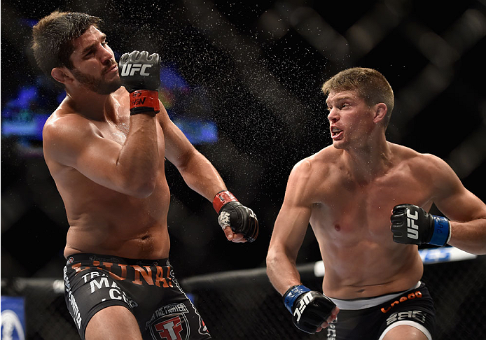 LAS VEGAS, NV - SEPTEMBER 27:  (R-L) Josh Thompson punches Patrick Cote in their welterweight fight during the UFC 178 event inside the MGM Grand Garden Arena on September 27, 2014 in Las Vegas, Nevada.  (Photo by Jeff Bottari/Zuffa LLC/Zuffa LLC via Gett