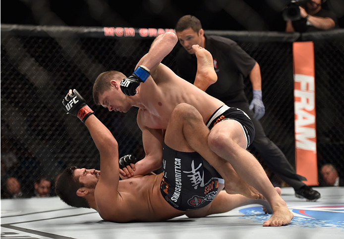 LAS VEGAS, NV - SEPTEMBER 27:  (Top) Josh Thompson punches Patrick Cote in their welterweight fight during the UFC 178 event inside the MGM Grand Garden Arena on September 27, 2014 in Las Vegas, Nevada.  (Photo by Jeff Bottari/Zuffa LLC/Zuffa LLC via Gett