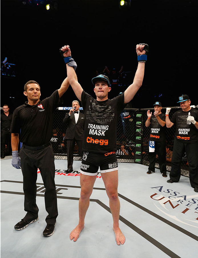 LAS VEGAS, NV - SEPTEMBER 27:  Josh Thompson celebrates his victory over Patrick Cote in their welterweight fight during the UFC 178 event inside the MGM Grand Garden Arena on September 27, 2014 in Las Vegas, Nevada.  (Photo by Josh Hedges/Zuffa LLC/Zuffa