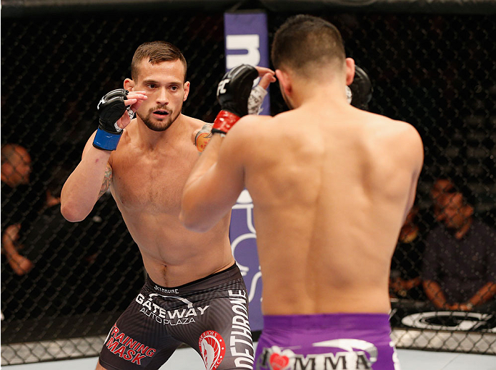 LAS VEGAS, NV - SEPTEMBER 27:  (L-R) James Krause squares off with Jorge Masvidal in their lightweight fight during the UFC 178 event inside the MGM Grand Garden Arena on September 27, 2014 in Las Vegas, Nevada.  (Photo by Josh Hedges/Zuffa LLC/Zuffa LLC