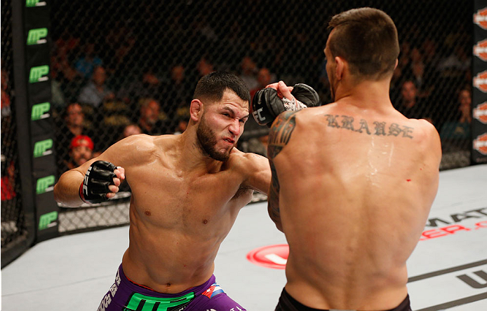 LAS VEGAS, NV - SEPTEMBER 27:  (L-R) Jorge Masvidal punches James Krause in their lightweight fight during the UFC 178 event inside the MGM Grand Garden Arena on September 27, 2014 in Las Vegas, Nevada.  (Photo by Josh Hedges/Zuffa LLC/Zuffa LLC via Getty
