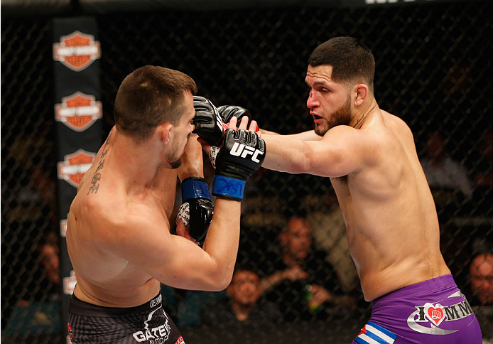 LAS VEGAS, NV - SEPTEMBER 27:  (R-L) Jorge Masvidal punches James Krause in their lightweight fight during the UFC 178 event inside the MGM Grand Garden Arena on September 27, 2014 in Las Vegas, Nevada.  (Photo by Josh Hedges/Zuffa LLC/Zuffa LLC via Getty