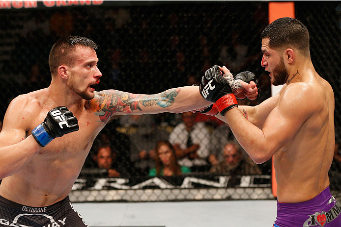 LAS VEGAS, NV - SEPTEMBER 27:  (L-R) James Krause punches Jorge Masvidal in their lightweight fight during the UFC 178 event inside the MGM Grand Garden Arena on September 27, 2014 in Las Vegas, Nevada.  (Photo by Josh Hedges/Zuffa LLC/Zuffa LLC via Getty