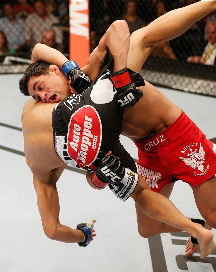 LAS VEGAS, NV - SEPTEMBER 27:  (L-R) Dominick Cruz takes down Takeya Mizugaki in their bantamweight fight during the UFC 178 event inside the MGM Grand Garden Arena on September 27, 2014 in Las Vegas, Nevada.  (Photo by Josh Hedges/Zuffa LLC/Zuffa LLC via