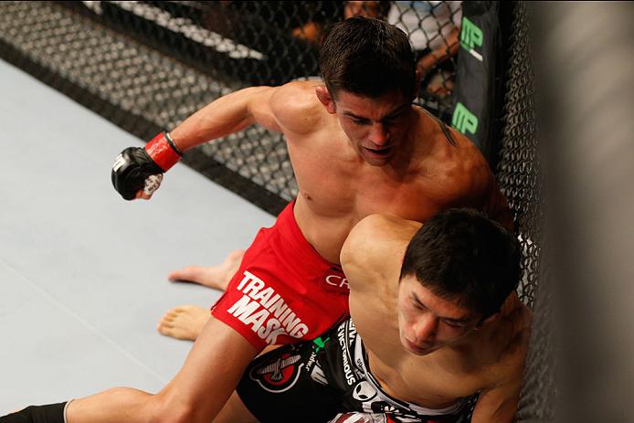 LAS VEGAS, NV - SEPTEMBER 27:  (L-R) Dominick Cruz punches Takeya Mizugaki in their bantamweight fight during the UFC 178 event inside the MGM Grand Garden Arena on September 27, 2014 in Las Vegas, Nevada.  (Photo by Josh Hedges/Zuffa LLC/Zuffa LLC via Ge