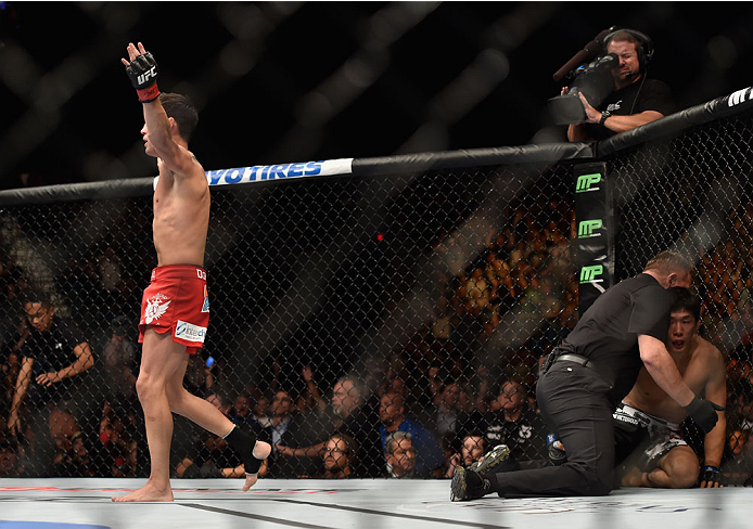 LAS VEGAS, NV - SEPTEMBER 27:  Dominick Cruz celebrates after his TKO victory over Takeya Mizugaki in their bantamweight fight during the UFC 178 event inside the MGM Grand Garden Arena on September 27, 2014 in Las Vegas, Nevada.  (Photo by Jeff Bottari/Z