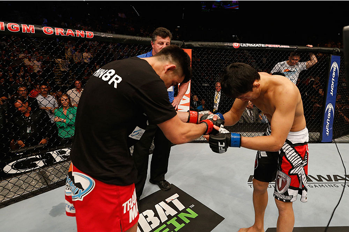 LAS VEGAS, NV - SEPTEMBER 27:  (L-R) Dominick Cruz and Takeya Mizugaki show respect towards each other after their bantamweight fight during the UFC 178 event inside the MGM Grand Garden Arena on September 27, 2014 in Las Vegas, Nevada.  (Photo by Josh He