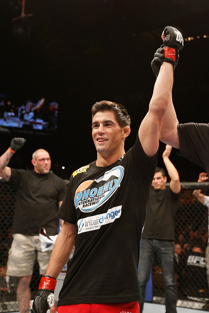 LAS VEGAS, NV - SEPTEMBER 27:  Dominick Cruz celebrates after his TKO victory over Takeya Mizugaki in their bantamweight fight during the UFC 178 event inside the MGM Grand Garden Arena on September 27, 2014 in Las Vegas, Nevada.  (Photo by Josh Hedges/Zu