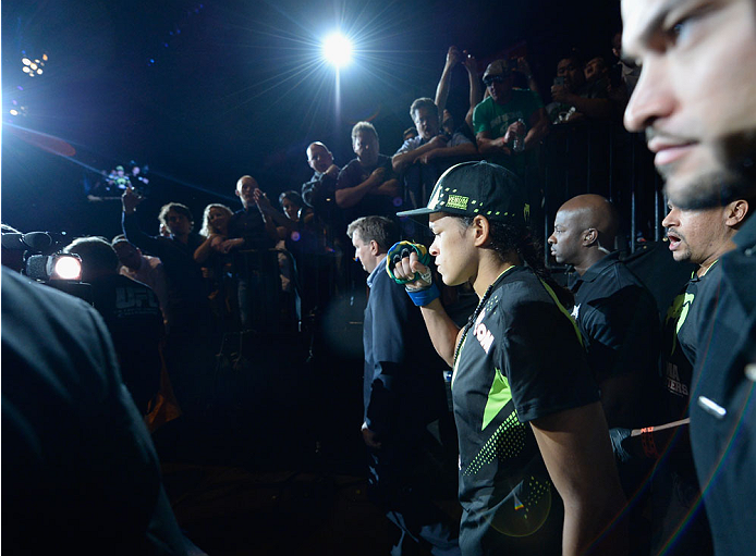 LAS VEGAS, NV - SEPTEMBER 27:  Amanda Nunes prepares to enter the Octagon before facing Cat Zingano in their women's bantamweight fight during the UFC 178 event inside the MGM Grand Garden Arena on September 27, 2014 in Las Vegas, Nevada.  (Photo by Jeff