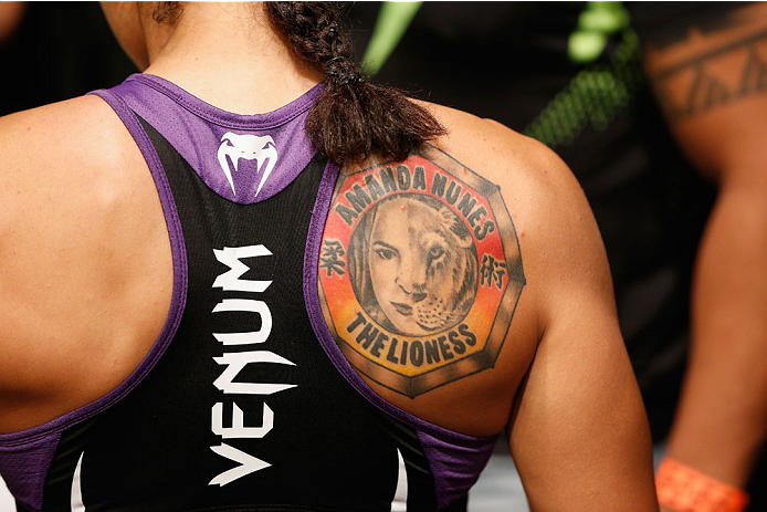 LAS VEGAS, NV - SEPTEMBER 27:  Amanda Nunes enters the Octagon for her fight with Cat Zingano in their women's bantamweight fight during the UFC 178 event inside the MGM Grand Garden Arena on September 27, 2014 in Las Vegas, Nevada.  (Photo by Josh Hedges