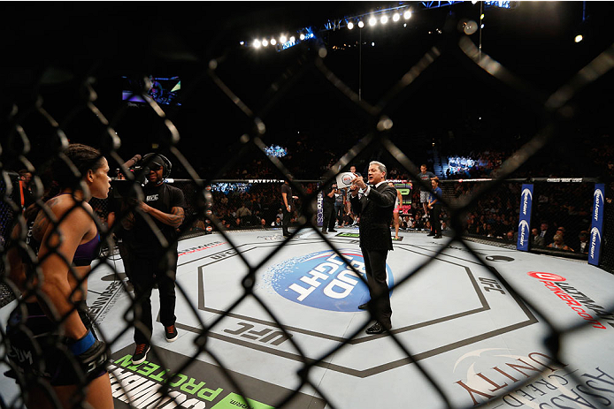 LAS VEGAS, NV - SEPTEMBER 27:  Bruce Butter announces the fight between Amanda Nunes and Cat Zingano in their women's bantamweight fight during the UFC 178 event inside the MGM Grand Garden Arena on September 27, 2014 in Las Vegas, Nevada.  (Photo by Josh