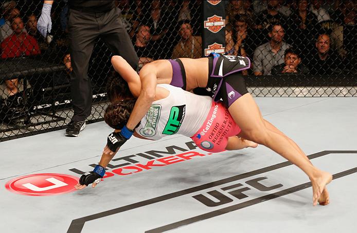 LAS VEGAS, NV - SEPTEMBER 27:  (Bottom) Cat Zingano takes down Amanda Nunes in their women's bantamweight fight during the UFC 178 event inside the MGM Grand Garden Arena on September 27, 2014 in Las Vegas, Nevada.  (Photo by Josh Hedges/Zuffa LLC/Zuffa L