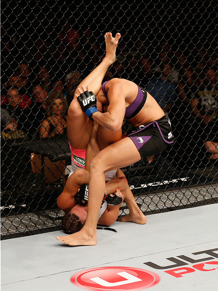 LAS VEGAS, NV - SEPTEMBER 27:  (Bottom) Cat Zingano attempts an arm bar on Amanda Nunes in their women's bantamweight fight during the UFC 178 event inside the MGM Grand Garden Arena on September 27, 2014 in Las Vegas, Nevada.  (Photo by Josh Hedges/Zuffa