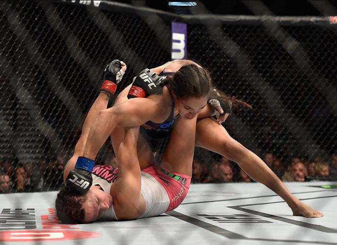 LAS VEGAS, NV - SEPTEMBER 27:  (Top) Amanda Nunes punches Cat Zingano in their women's bantamweight fight during the UFC 178 event inside the MGM Grand Garden Arena on September 27, 2014 in Las Vegas, Nevada.  (Photo by Jeff Bottari/Zuffa LLC/Zuffa LLC vi