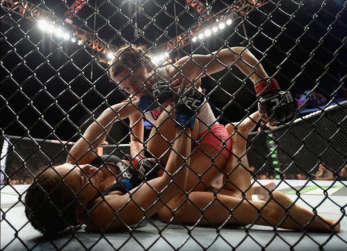 LAS VEGAS, NV - SEPTEMBER 27:  (Top) Cat Zingano punches Amanda Nunes in their women's bantamweight fight during the UFC 178 event inside the MGM Grand Garden Arena on September 27, 2014 in Las Vegas, Nevada.  (Photo by Jeff Bottari/Zuffa LLC/Zuffa LLC vi