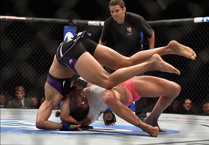 LAS VEGAS, NV - SEPTEMBER 27:  Cat Zingano takes down Amanda Nunes in their women's bantamweight fight during the UFC 178 event inside the MGM Grand Garden Arena on September 27, 2014 in Las Vegas, Nevada.  (Photo by Jeff Bottari/Zuffa LLC/Zuffa LLC via G