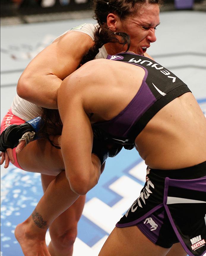 LAS VEGAS, NV - SEPTEMBER 27:  (L-R) Cat Zingano knees Amanzda Nunes in their women's bantamweight fight during the UFC 178 event inside the MGM Grand Garden Arena on September 27, 2014 in Las Vegas, Nevada.  (Photo by Josh Hedges/Zuffa LLC/Zuffa LLC via