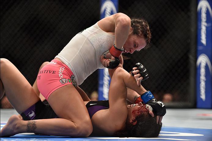 LAS VEGAS, NV - SEPTEMBER 27:  (Top) Cat Zingano elbows Amanda Nunes in their women's bantamweight fight during the UFC 178 event inside the MGM Grand Garden Arena on September 27, 2014 in Las Vegas, Nevada.  (Photo by Jeff Bottari/Zuffa LLC/Zuffa LLC via