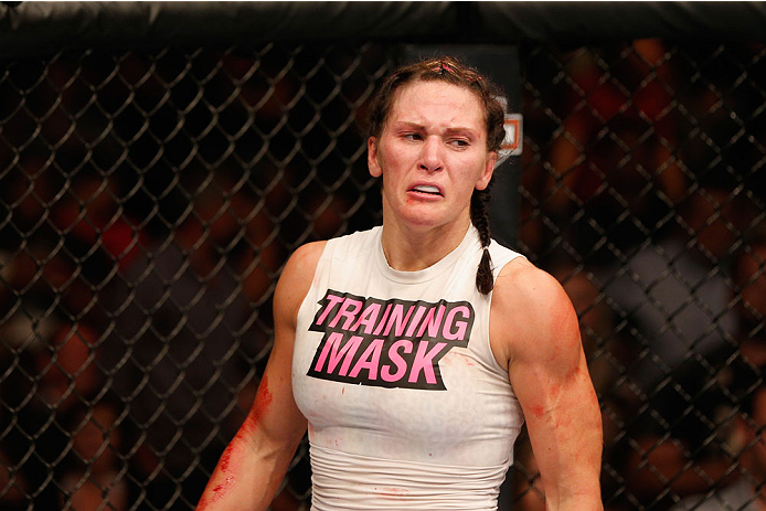 LAS VEGAS, NV - SEPTEMBER 27:  Cat Zingano celebrates after her TKO win over Amanda Nunes in their women's bantamweight fight during the UFC 178 event inside the MGM Grand Garden Arena on September 27, 2014 in Las Vegas, Nevada.  (Photo by Josh Hedges/Zuf