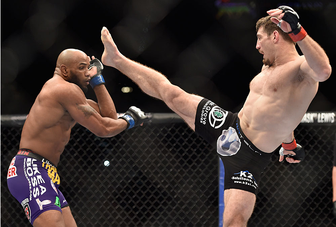 LAS VEGAS, NV - SEPTEMBER 27:  (R-L) Tim Kennedy throws a kick at Yoel Romero in their middleweight fight during the UFC 178 event inside the MGM Grand Garden Arena on September 27, 2014 in Las Vegas, Nevada.  (Photo by Jeff Bottari/Zuffa LLC/Zuffa LLC vi