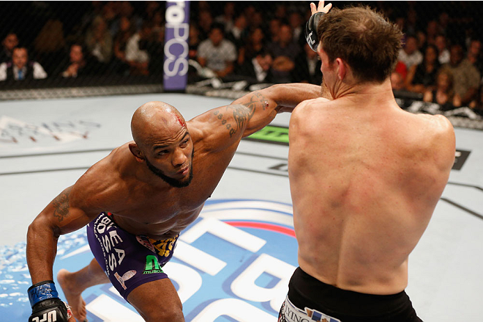 LAS VEGAS, NV - SEPTEMBER 27:  (L-R) Yoel Romero punches Tim Kennedy in their middleweight fight during the UFC 178 event inside the MGM Grand Garden Arena on September 27, 2014 in Las Vegas, Nevada.  (Photo by Josh Hedges/Zuffa LLC/Zuffa LLC via Getty Im