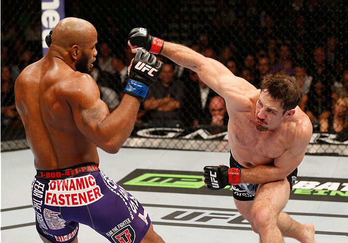 LAS VEGAS, NV - SEPTEMBER 27:  (R-L) Tim Kennedy punches Yoel Romero in their middleweight fight during the UFC 178 event inside the MGM Grand Garden Arena on September 27, 2014 in Las Vegas, Nevada.  (Photo by Josh Hedges/Zuffa LLC/Zuffa LLC via Getty Im