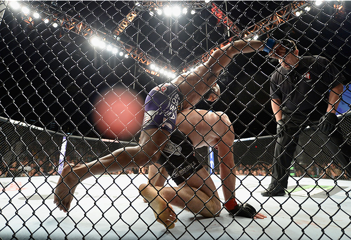 LAS VEGAS, NV - SEPTEMBER 27:  (Top) Yoel Romero punches Tim Kennedy in their middleweight fight during the UFC 178 event inside the MGM Grand Garden Arena on September 27, 2014 in Las Vegas, Nevada.  (Photo by Jeff Bottari/Zuffa LLC/Zuffa LLC via Getty I