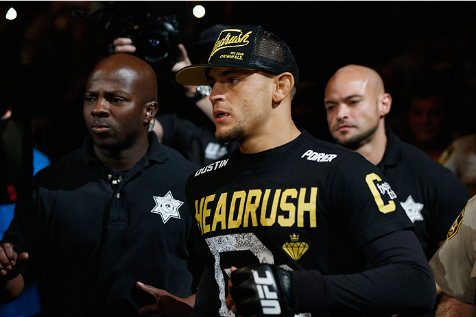 LAS VEGAS, NV - SEPTEMBER 27:  Dustin Poirier enters the arena for his fight with Conor McGregor before their featherweight fight during the UFC 178 event inside the MGM Grand Garden Arena on September 27, 2014 in Las Vegas, Nevada.  (Photo by Josh Hedges