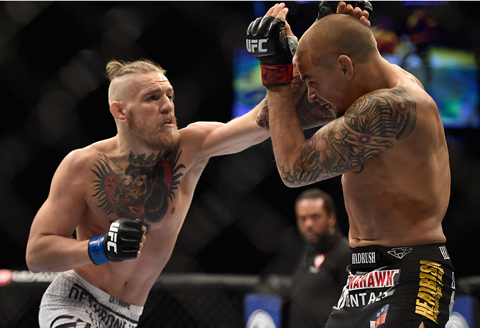 LAS VEGAS, NV - SEPTEMBER 27:  (L-R) Conor McGregor punches Dustin Poirier in their featherweight fight during the UFC 178 event inside the MGM Grand Garden Arena on September 27, 2014 in Las Vegas, Nevada.  (Photo by Jeff Bottari/Zuffa LLC/Zuffa LLC via