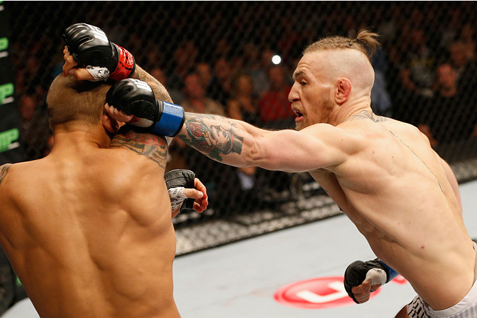LAS VEGAS, NV - SEPTEMBER 27:  (L-R) Conor McGregor punches Dustin Poirier in their featherweight fight during the UFC 178 event inside the MGM Grand Garden Arena on September 27, 2014 in Las Vegas, Nevada.  (Photo by Josh Hedges/Zuffa LLC/Zuffa LLC via G
