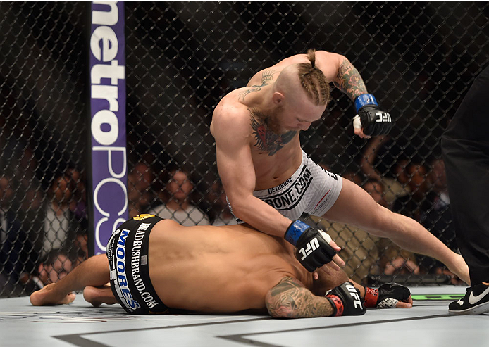 LAS VEGAS, NV - SEPTEMBER 27:  (Top) Conor McGregor punches Dustin Poirier in their featherweight fight during the UFC 178 event inside the MGM Grand Garden Arena on September 27, 2014 in Las Vegas, Nevada.  (Photo by Jeff Bottari/Zuffa LLC/Zuffa LLC via
