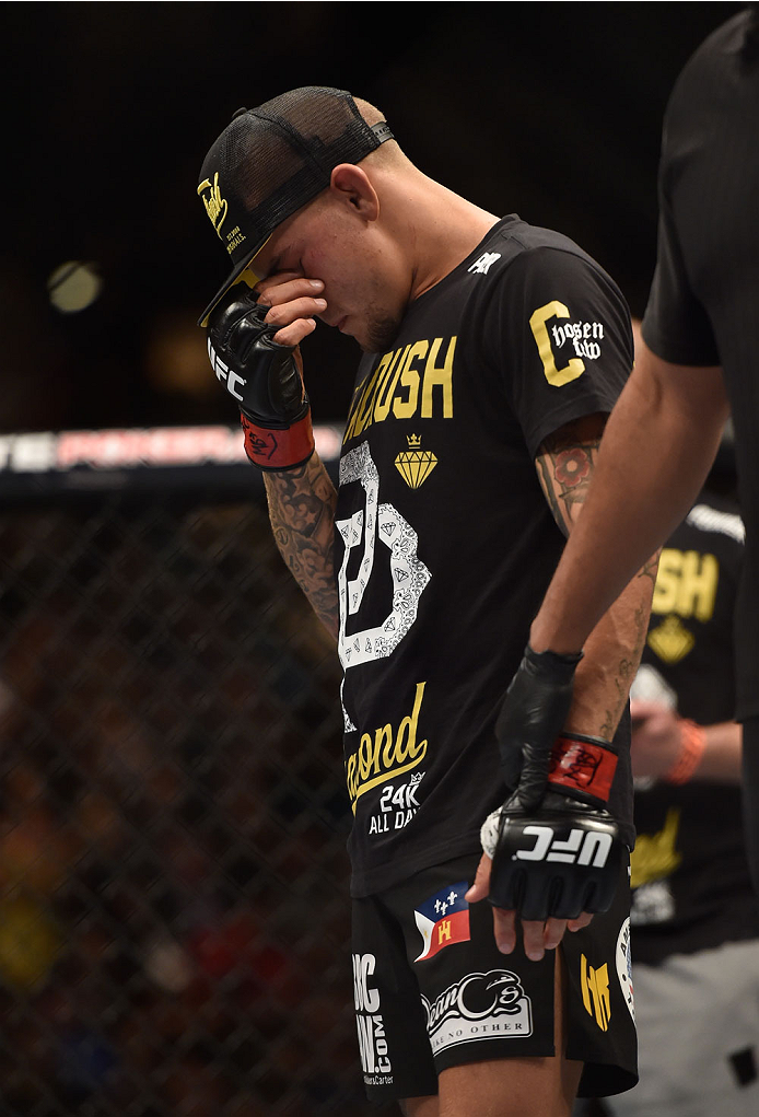 LAS VEGAS, NV - SEPTEMBER 27:  Dustin Poirier reacts to his TKO loss to Conor McGregor in their featherweight fight with during the UFC 178 event inside the MGM Grand Garden Arena on September 27, 2014 in Las Vegas, Nevada.  (Photo by Jeff Bottari/Zuffa L