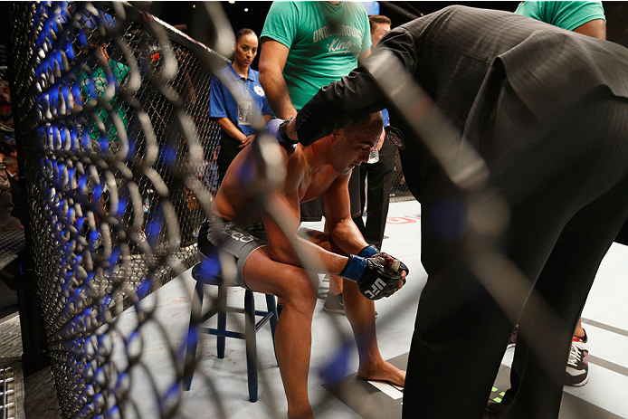 LAS VEGAS, NV - SEPTEMBER 27:  Eddie Alvarez recovers after his fight with Donald Cerrone in their lightweight fight during the UFC 178 event inside the MGM Grand Garden Arena on September 27, 2014 in Las Vegas, Nevada.  (Photo by Josh Hedges/Zuffa LLC/Zu