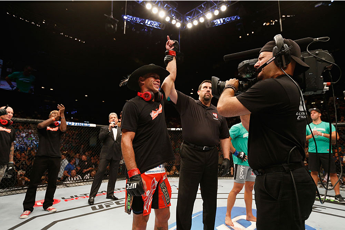 LAS VEGAS, NV - SEPTEMBER 27:  (L-R) Donald Cerrone celebrates his victory over Eddie Alvarez after their lightweight fight during the UFC 178 event inside the MGM Grand Garden Arena on September 27, 2014 in Las Vegas, Nevada.  (Photo by Josh Hedges/Zuffa