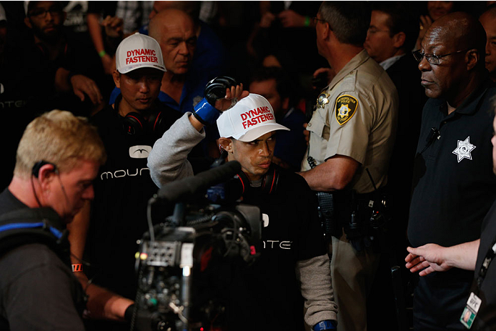 LAS VEGAS, NV - SEPTEMBER 27:  Challenger Chris Cariaso enters the arena before his flyweight championship fight with Demetrious Johnson during the UFC 178 event inside the MGM Grand Garden Arena on September 27, 2014 in Las Vegas, Nevada.  (Photo by Josh