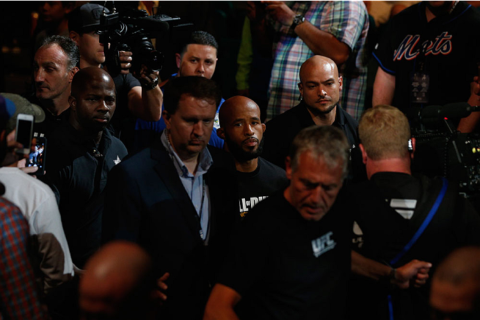 LAS VEGAS, NV - SEPTEMBER 27:  UFC Flyweight champion Demetrious Johnson enters the arena for his flyweight championship fight with Chris Cariaso during the UFC 178 event inside the MGM Grand Garden Arena on September 27, 2014 in Las Vegas, Nevada.  (Phot