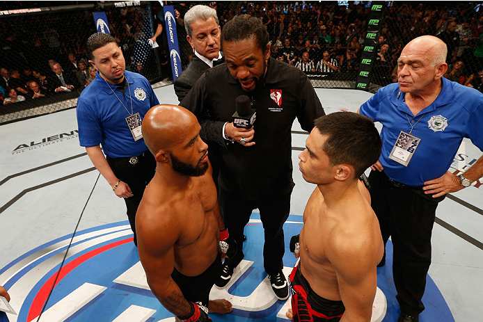 LAS VEGAS, NV - SEPTEMBER 27:  UFC Flyweight champion Demetrious Johnson faces off with challenger Chris Cariaso in their flyweight championship fight during the UFC 178 event inside the MGM Grand Garden Arena on September 27, 2014 in Las Vegas, Nevada.