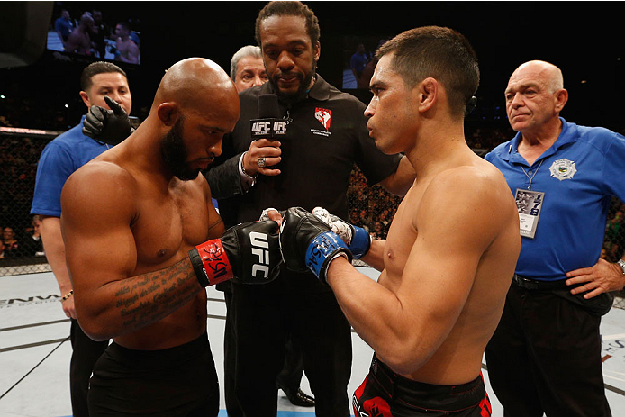 LAS VEGAS, NV - SEPTEMBER 27:  (L-R) UFC Flyweight champion Demetrious Johnson touches gloves with Chris Cariaso before their flyweight championship fight during the UFC 178 event inside the MGM Grand Garden Arena on September 27, 2014 in Las Vegas, Nevad