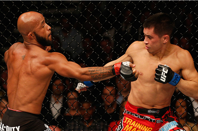 LAS VEGAS, NV - SEPTEMBER 27:  (L-R) Demetrious Johnson punches Chris Cariaso in their flyweight championship fight during the UFC 178 event inside the MGM Grand Garden Arena on September 27, 2014 in Las Vegas, Nevada.  (Photo by Josh Hedges/Zuffa LLC/Zuf